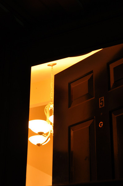 door assignment - I decided to photograph my own front door, and contrast the warm, inviting light inside with the blackness surrounding it