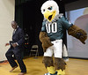 """Bob Raines--Montgomery Media / Dr. Orlando Taylor, principal of Inglewood Elementary School joins the Eagles mascot, """"Swoop,"""" on stage during an autism awareness assembly May 22, 2015."""