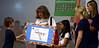 Bob Raines--Montgomery Media / Fourth-graders Tyler Sutowski and Munzilla Nushrat present a check to Patti Erickson president of the Autism Society of Philadelphia at Inglewood Elementary School, Lansdale, May 22, 2015.