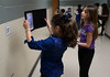 Bob Raines--Montgomery Media / Mia Fusco and Gianna Lennox photograph QR codes containing information on autism scattered along hallways at Inglewood Elementary School May 22, 2015 as part of an autism scavenger hunt.
