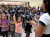 Inglewood Elementary School girls try out Eagles Cheerleader pom-poms.