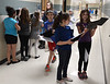 Bob Raines--Montgomery Media / Mia Fusco and Gianna Lennox compare their results as they and their classmates take part in an autism scavenger hunt using iPads to photograph QR codes scattered along hallways at Inglewood Elementary School May 22, 2015.