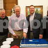Tyler Mayor Martin Heines cuts the cake at a reception at Main Street Gallery Thursday for the 20th anniversary of Tyler voters approving the half-cent sales tax. Tyler adopted the half-cent sales tax in 1995. Each year, it collects approximately $13 million in half-cent sales tax revenues, which has allowed the city to pay cash for capital improvements. Pictured from left: city councilman Don Warren, Mayor Martin Heines, and councilmen John Nix and Ed Moore.<br /> <br /> (Sarah A. Miller/Tyler Morning Telegraph)