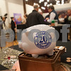 Piggy banks decorate tables at a reception at Main Street Gallery Thursday for the 20th anniversary of Tyler voters approving the half-cent sales tax. Tyler adopted the half-cent sales tax in 1995. Each year, it collects approximately $13 million in half-cent sales tax revenues, which has allowed the city to pay cash for capital improvements. <br /> <br /> (Sarah A. Miller/Tyler Morning Telegraph)