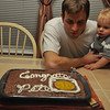 Pete teaching Little Man how to blow out cake candles...it would prove helpful because Amy had 29 to blow out!  Whew!!