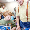 Jack Lokey played adopted granddad Friday at Plato Elementary for student Marion Campbell, helping him choose books at the Scholastic Book Fair on Grandparents Day.