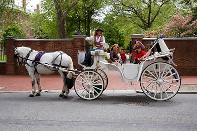 Mrs. Martino-Dunns leads a group on a horse carriage