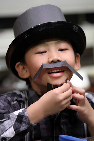 Brandon figures he needs a moustache and a gotee to complete the look, so here he is makin some from the left-over construction paper and some double-sided tape. The facial hair is completely his idea and his execution!  Pocopson Old-Fashion Day, celebrating Thanksgiving 2010
