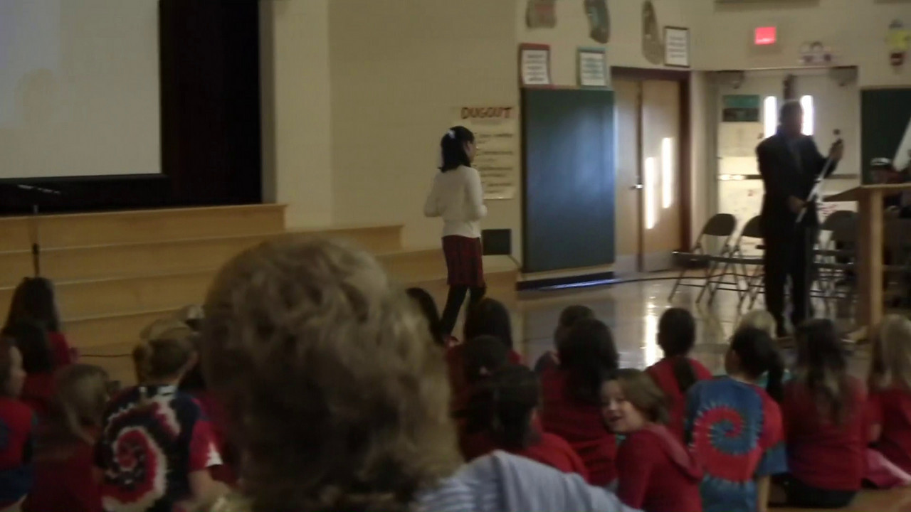 Katelyn reads the Presidential Veterans Day Proclaimation, on behalf of the students of the Pocopson Elementary School, on its 2010 Veterans Day assembly.<br /> <br /> Veterans Day 2010<br /> 11/11/2010
