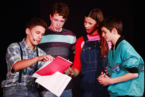 From left, Corey Palmer played by 9th grader Caleb Yauger reveals his election plan while running for class president to Alf Bueller played by 8th grader Eli Stroh, Andie Carlisle played by 10th grader Abby Green and Kirk Keaton played by 8th grader Aidan Ramsey- a concert, similar to that of the Live Aid concerts, to help fund the school prom.