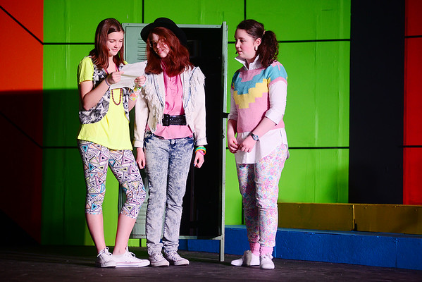 From left Laura Wilde played by 9th grader Amy Miller and Debbie Fox played by 10th grader Hope Merrill find the love note for Eileen Reagan played by 12th grader Ria Schlacter left by Michael and his friends.