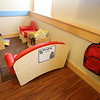 Recently opened Primrose School on North Road in Chelmsford, which has infant day care through kindergarten.  Reading nook in one of two Pre-K classrooms, which are in what used to be the church. Each age group has a different style backpack. (SUN/Julia Malakie)