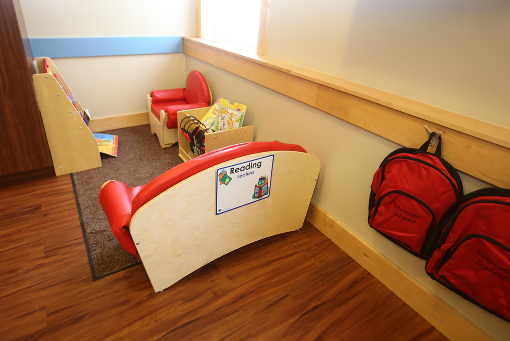 . Recently opened Primrose School on North Road in Chelmsford, which has infant day care through kindergarten.  Reading nook in one of two Pre-K classrooms, which are in what used to be the church. Each age group has a different style backpack. (SUN/Julia Malakie)