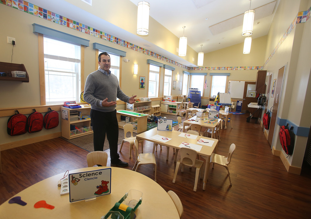 . Rob Parsons gives a tour of the recently opened Primrose School on North Road in Chelmsford, which has infant day care through kindergarten.  This is one of two Pre-K classrooms, which are in what used to be the church. They were able to keep the church\'s light fixtures. (SUN/Julia Malakie)