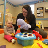 Infant teacher Nicole Zechner of Chelmsford, with Laci Smith, 9 months old, whose mother works at the school, at the recently Primrose School on North Road in Chelmsford, which has infant day care through kindergarten.  (SUN/Julia Malakie)