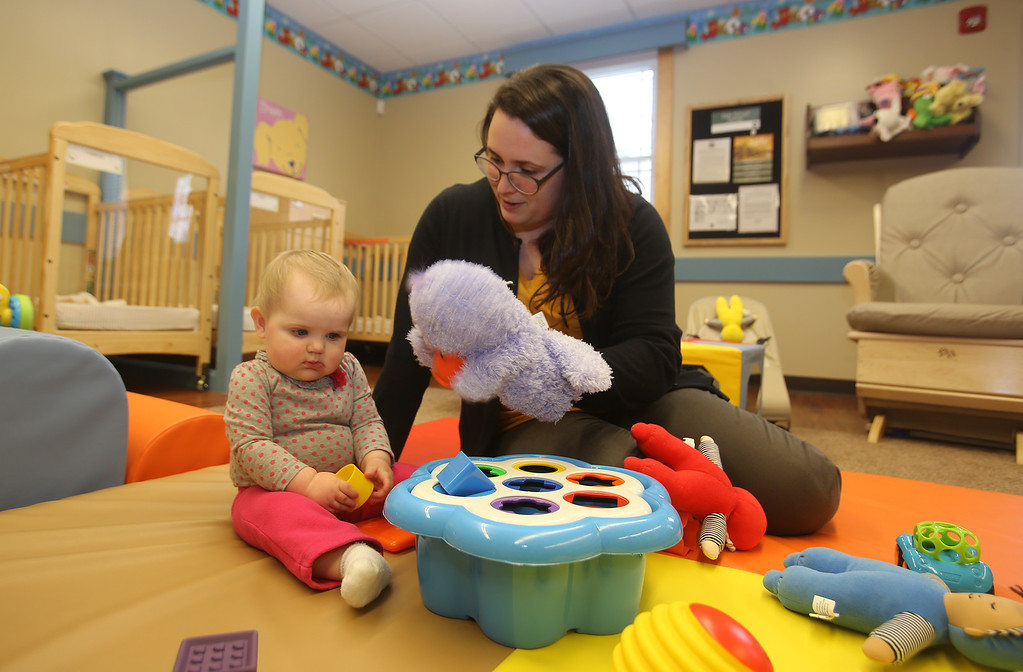 . Infant teacher Nicole Zechner of Chelmsford, with Laci Smith, 9 months old, whose mother works at the school, at the recently Primrose School on North Road in Chelmsford, which has infant day care through kindergarten.  (SUN/Julia Malakie)
