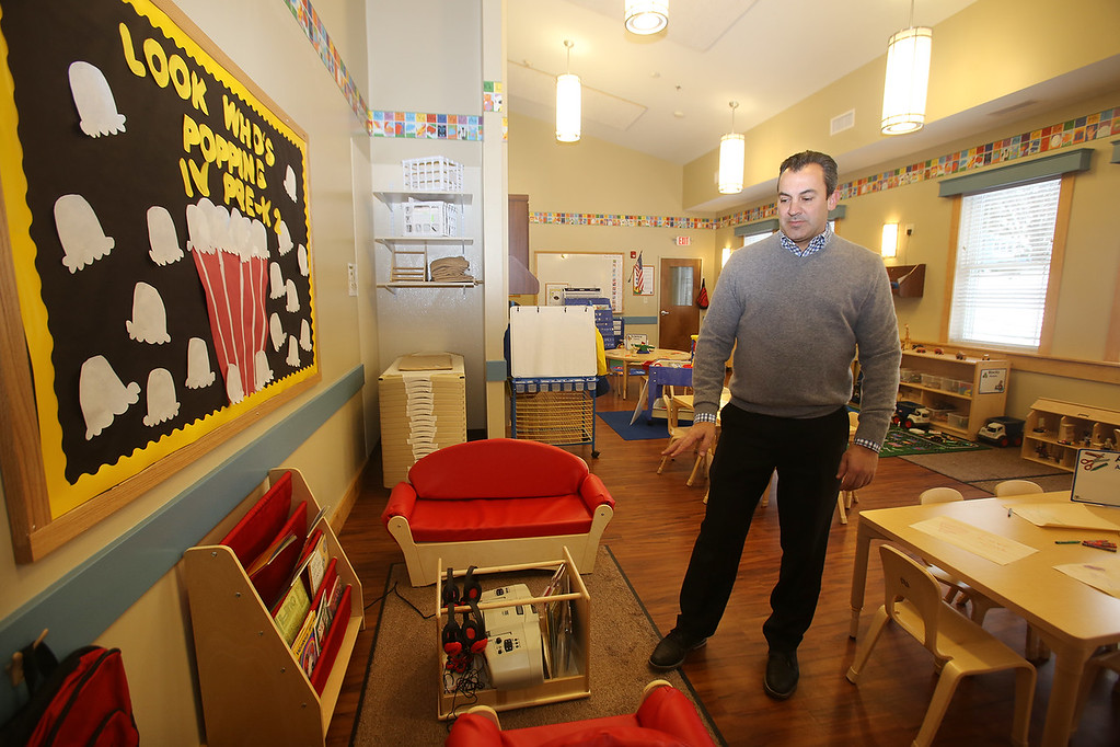 . Rob Parsons gives a tour of the recently opened Primrose School on North Road in Chelmsford, which has infant day care through kindergarten.  This is one of two Pre-K classrooms, which are in what used to be the church. They were able to keep the light fixtures exactly where they\'d been in the church. (SUN/Julia Malakie)