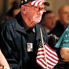 Wayne Ellsworth, Army veteran, wears his red, white & blue hat during the Veteran's Day program at Anderson High School.