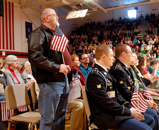 Nick Brewer, an Army veteran, stands to be recognized as his name was read off during the Veteran's Day program at Anderson High School.