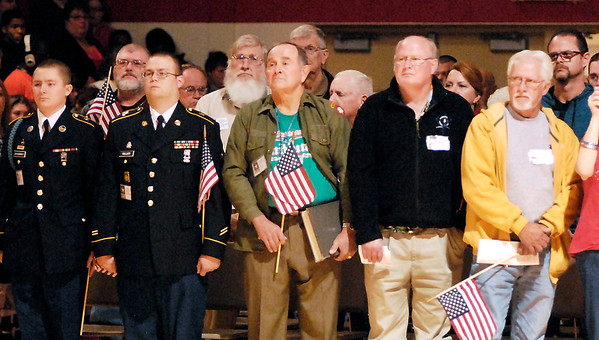 Veterans stand during the playing of Stars & Stripes Forever.