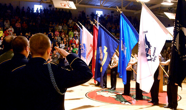 Chase Shumway, of the Army National Guard, salutes during the presentation of Colors and the playing of the National Anthem.