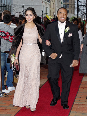 """Anderson High School's 2015 Prom was held Saturday evening at the Paramount Ballroom to the theme of """"Casino Night in Vegas.""""<br /> Lidia Osuna and FreSan Reese walk the red carpet to the Anderson High School prom."""