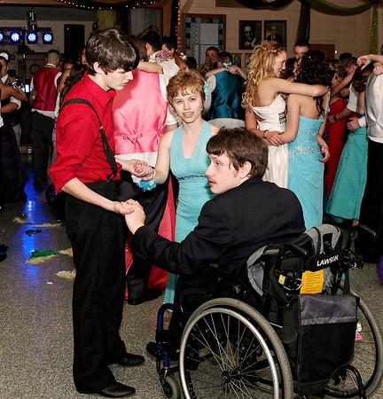 Jake Manship, Autumn Chestnut and Justin Jamison dance together at the Elwood High School prom.