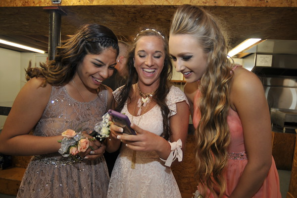 John P. Cleary | The Herald Bulletin<br />   Sarah Cabello, sophomore, Shaylie Rayl, senior, and Shealah Davis, junior, all get a laugh from the photo that they had just taken during Liberty Christian School's 2015 banquet Saturday evening.