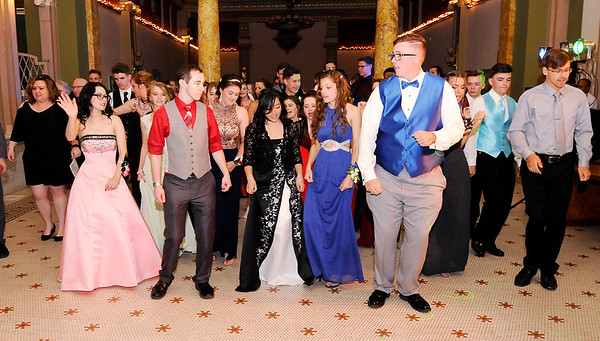 Don Knight | The Herald Bulletin<br /> Students dance the Cha-Cha Slide during APA's prom at The Anderson Center for the Arts on Saturday.