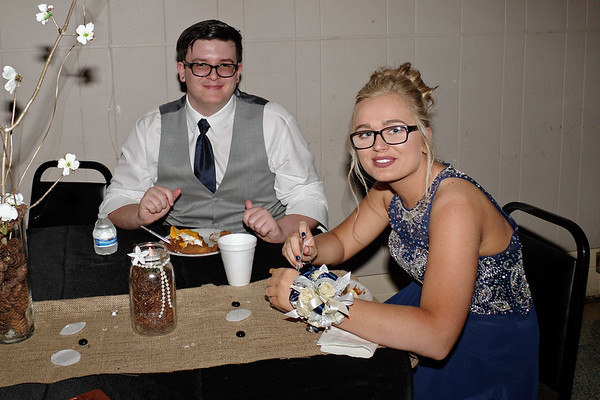 "Elwood High School Prom attendees Brakken Troutman and Emilie Creasy enjoy some refreshments in the ""Enchanted Forest."""