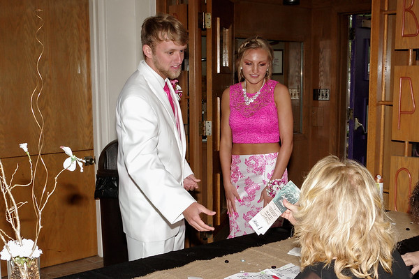 """Jake Ebert and Kaylee Lane present their tickets for admission to the """"Enchanted Forest"""" Elwood High School Prom."""