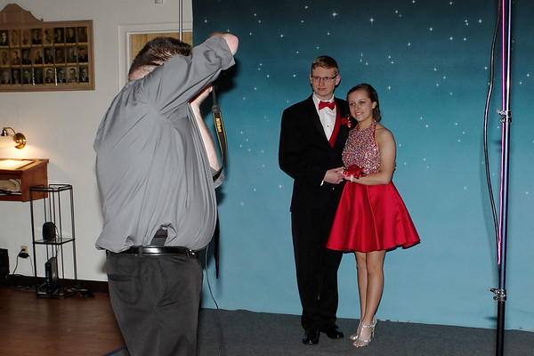 "Alex Kane and Sydney Bright pose for their photo at Elwood High School's ""Enchantd Forest"" themed prom."