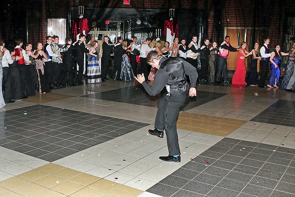 Mark Maynard | for The Herald Bulletin<br /> Ringed by a conga-line, Chris Lee shows off his solo dance moves at the Lapel High School prom.