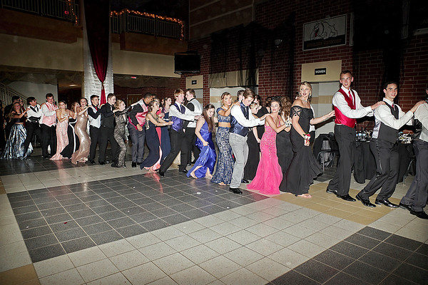 "Mark Maynard | for The Herald Bulletin<br /> A conga-line snakes around the dance floor at Lapel High School during the ""Phantom of the Opera"" prom on Saturday."