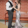 Mark Maynard | for The Herald Bulletin<br /> Escaping the crowded floor during Lapel High School's prom, Hunter Brinson and Joelle Miller share a dance on the mezzanine.