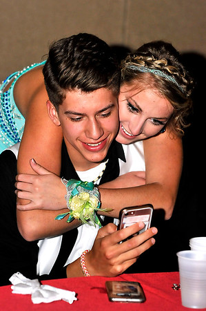John P. Cleary | The Herald Bulletin<br /> Michael McGuire and Gabby Leavell check out the photos they have taken during the Madison-Grant High School Prom Saturday evening.