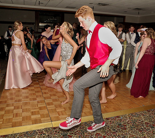 """Shenandoah High School students dance to """"Cotton-eyed Joe"""" during their prom on Saturday night at the Anderson Country Club.  (Mark Maynard photo)"""