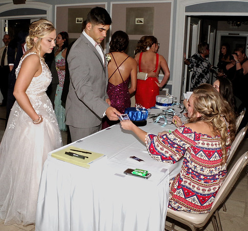 Kamryn Buck and Silas Allred  present their Shenandoah High School Prom tickets to Bridget Lohray upon their arrival at the Anderson Country Club.  (Mark Maynard photo)