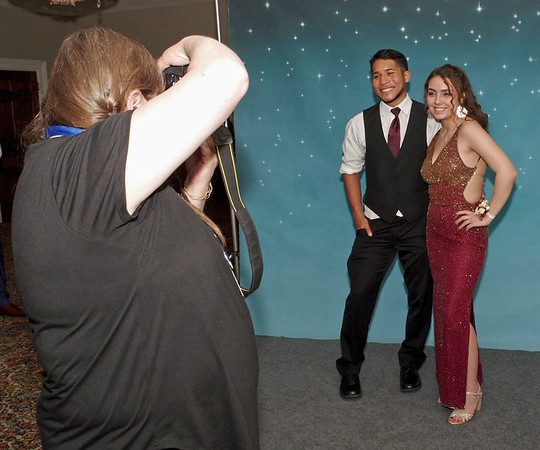 Malachi Allred and Rose Canto pose for their prom portrait. (Mark Maynard photo)
