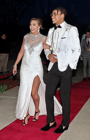 Mark Maynard | for The Herald Bulletin<br /> Kelsi Lawyer and Eli Pancol stroll along the red carpet entering the Shenandoah High School Prom on Saturday night.