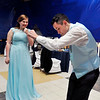 """Lapel High School 2018 Prom.<br /> Abbie McClure smiles and watches as Mason Santes goes through his moves while dancing at the song """"Foot Loose."""""""