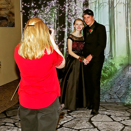 "Mark Maynard | for The Herald Bulletin<br /> Hannah Holmberg and Dylan Hampton pose for photographer Megan Buckmaster at Madison-Grant's ""Enchanted Forest"" prom in the Horizon Center."