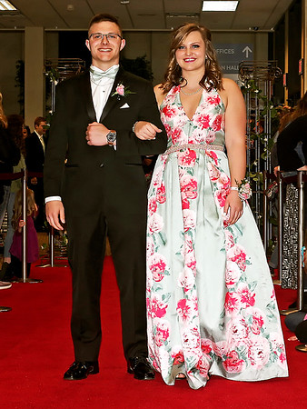 "Mark Maynard | for The Herald Bulletin<br /> Alex Webb and Alie Carson arrive on the red carpet for the Madison-Grant ""Enchanted Forest"" prom at the Horizon Center."