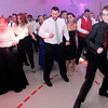 "Don Knight | The Herald Bulletin<br /> Everybody lines up for ""The Cupid Shuffle"" during the Frankton High School prom at The Factory on Saturday."