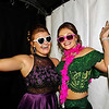 """Sarah Short and Lexi Hickman don some whimsical props as they prepare for a souvenir snapshot during the Lapel High School """"Greatest Showman"""" themed prom on Saturday night at the Paramount Theatre. (Mark Maynard photo)"""