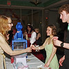 """Lapel High School calculus teacher Denise Hershberger-Gray serves up some cotton candy to Autumn Moles, as Aidan Sturgeon enjoys a snow cone during the """"Greatest Showman on Earth"""" themed Lapel Prom. (Mark Maynard photo)"""