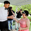 Don Knight | The Herald Bulletin<br /> Grant Kelley puts a corsage on Destiny McLemore's arm before taking her to Anderson High School's special needs prom on Thursday.