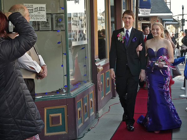 """Mark Maynard   for The Herald Bulletin<br /> Matthew Etherington and Hunter Granger pause for a picture as they stroll the red carpet leading to the Alexandria-Monroe High School """"Shine Bright Like a Diamond"""" prom."""