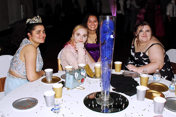 Anais Reynard, Katie Enyeart, Angelica Diaz and Brooke McIlwain take a break from the dance floor action during the Anderson High School Prom at the Paramount Ballroom on Saturday evening. (Mark Maynard photo)