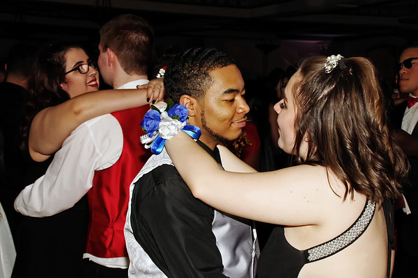 Couples share a slow dance during the Anderson High School Prom on Saturday evening at the Paramount Ballroom. (Mark Maynard photo)